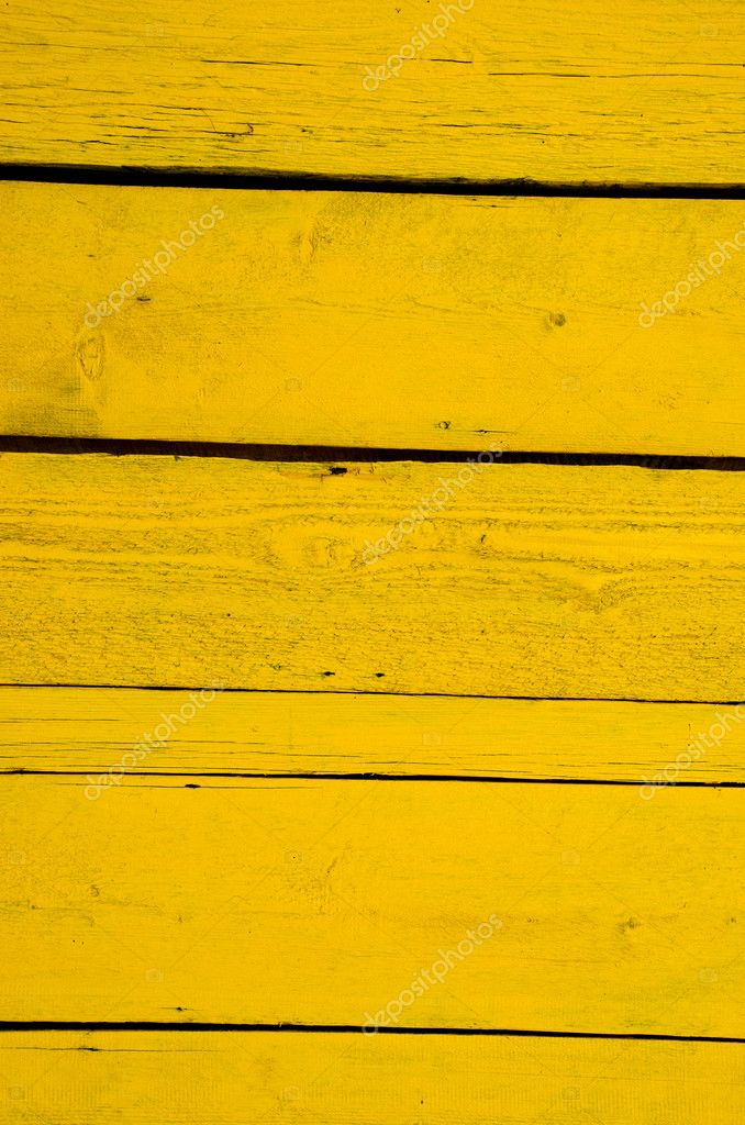 Wall made of wooden yellow planks. Interesting background. — Stock Photo #5868655