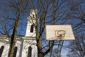 Basketball yard near church. — Stock Photo