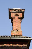 Antique red brick chimney. — Stock Photo