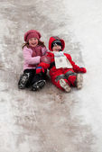 Children on icy descent — Stock Photo