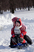 Children ride a snow-scooter — Stock Photo