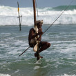 Traditional sri lankan stilt fisherman - Stock Photo