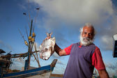 A man and a fish — Stock Photo