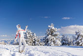 Cheery skier on the top of mountain — Stock Photo