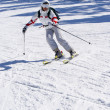 Beautiful skier skiing on the slope — Stock Photo