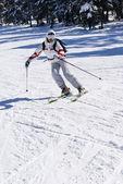 Beautiful skier skiing on the slope — Stock Photo