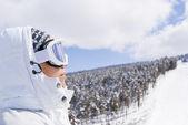 Portrait of beautiful skier looking forward — Stock Photo