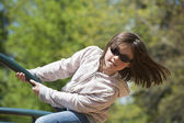 Girl leans out on ride. — Stock Photo