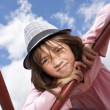 Brightly lit girl wearing hat. — Stock Photo