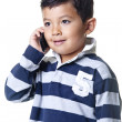 Stock Photo: Boy talks on phone.