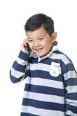 Young boy talks on phone. — Stockfoto