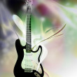 Electric guitar over abstract background — Stock Photo