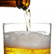 Pouring beer — Stock Photo