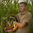 Stock Photo: Male farmer with a mixed harvest