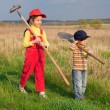 Two little children walking with tools — Stock Photo #5593521