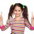 Little girl with victory sign — Stock Photo #5637045