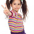 Little girl with victory sign — Stock Photo