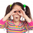Little girl looking through imaginary binocular - Stok fotoraf