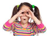 Little girl looking through imaginary binocular — Stock Photo