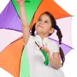 Little girl with umbrella, pointing up — Stock Photo