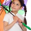 Little girl with umbrella, looking up — Stock Photo