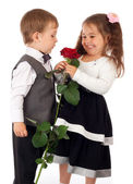 Two little children with red rose — Stock Photo