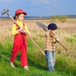 Stock Photo: Two little children walking with tools