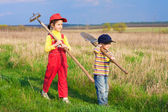 Two little children walking with tools — Stock Photo