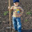 Stock Photo: Little children with big shovel