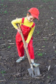 Little children with big shovel — Stock Photo