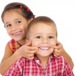 Two funny smiling little children - Stok fotoğraf