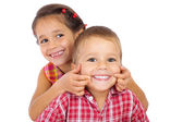 Two funny smiling little children — Foto Stock