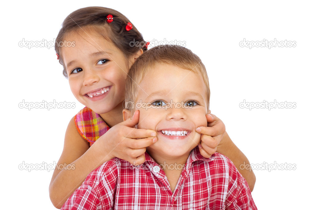 Two funny smiling little children, showing their teeth, isolated on white  Stock Photo #5960079