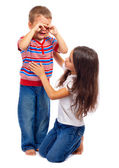 Girl calming down her little crying brother — Stock Photo