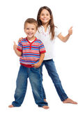 Two funny smiling little children with thumbs up sign — Stock Photo
