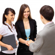 Attractive man and woman business team shaking hands at office building — Stock Photo #5432353