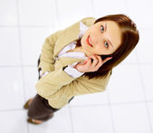 Young business woman holding the phone — Stock Photo