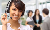 Friendly customer service consultants working — Stock Photo
