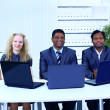 Royalty-Free Stock Photo: Interracial business team working at laptop in a modern office