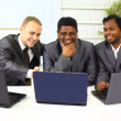 Interracial business team working at laptop in a modern office — Stock Photo #6727862