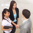 A pretty diverse young business team at office building handshake — Stock Photo