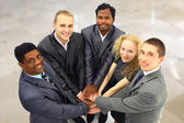 Portrait of friendly business team keeping their hands on top of each other — Stock Photo