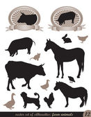 12 silhouettes of animals — Stock Vector