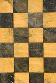 Grunge vintage chessboard background — Stock Photo