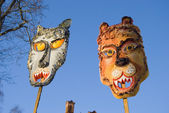 Two Mardi Gras masks on sky background — Stock Photo