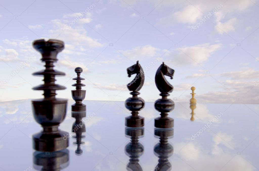 Blur chessmans on mirror and cloudy sky background — Stock Photo #5572203