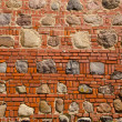 Royalty-Free Stock Photo: Red bricks and stones wall background