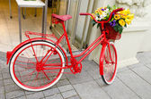 Vintage red bicycle in the street — Stock Photo