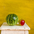 Yellow still-life with watermelon - Stock Photo
