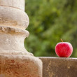 Red apple and column - Stock Photo